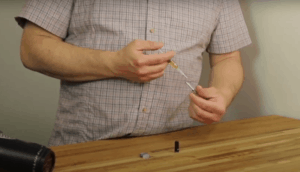 showing how to refill a vape cartridge with syringe